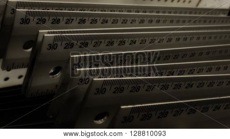 Centimeter rulers on showcase at hardware shop