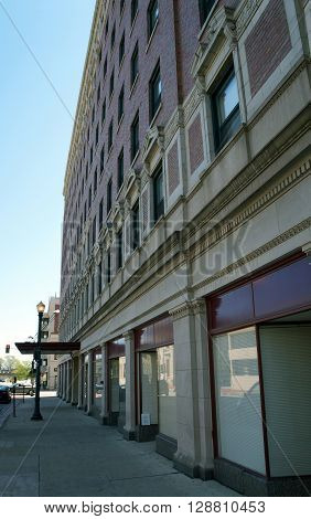 JOLIET, ILLINOIS / UNITED STATES - APRIL 26, 2015:  The Louis Joliet Apartment Building, built in a classical revival style in 1927, is an historic landmark in downtown Joliet.