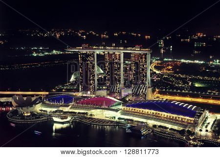 SINGAPORE - APR 5: Marina Bay Sands hotel at night on April 5, 2014 in Singapore. It is the world's most expensive building with cost of US$ 4.7 billion and landmark of Singapore.