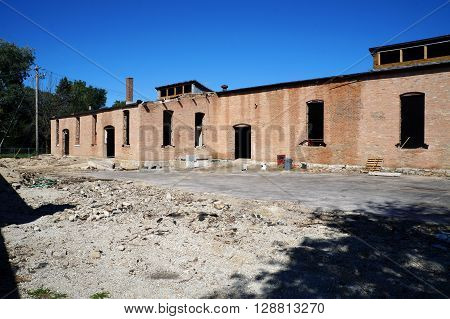An abandoned brick building in downtown Plainfield, Illinois.