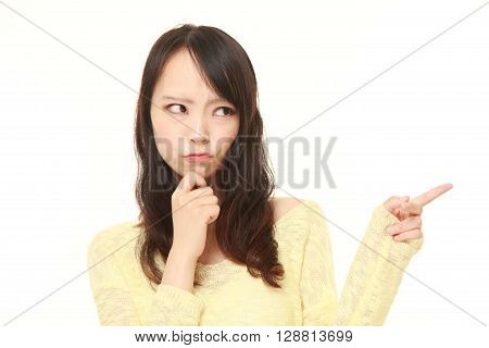 portrait of young Japanese woman doubting on white background