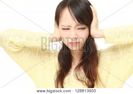 portrait of Young Japanese woman suffers from noise