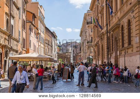 ROME, ITALY - APRIL 8, 2016: Street in the centre of Rome with people walking via the street
