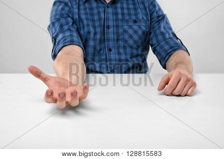 Close-up hands of man holding something in his palm. Palm up. Symbols and gestures. Body language. Hand gesture. Willingness to cooperate. Imitation.