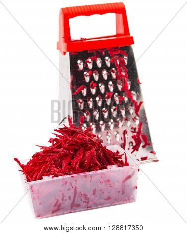 The composition of the grated beets. Nearby is grater and beets. Isolated on white background.