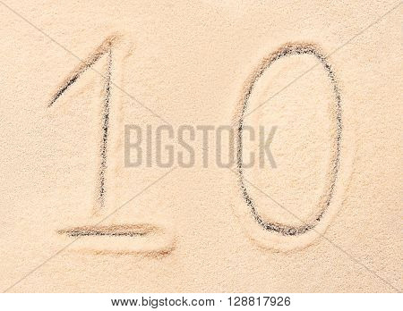 10 number written on sand, summer beach background