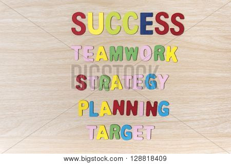 Step to go success Key words to success teamwork strategy planning target. Business success and marketing concept