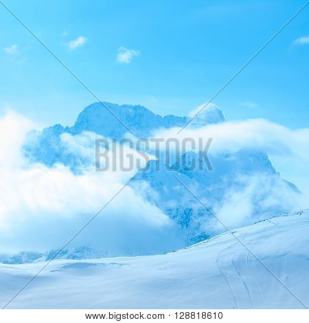 Beautiful Winter Landscape Of Dombaj With Clouds And Descent From The Mountain, Russia