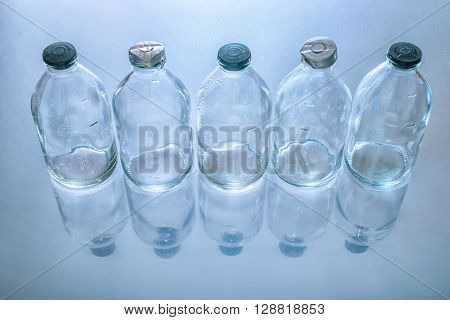 Top View Of Dirty Empty Vintage Glass Medicine Bottles With Stopper On Blue Background