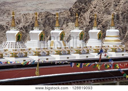 Buddhist white stupa and Himalayas mountains in the background in Thiksey Monastery in Leh Ladakh India