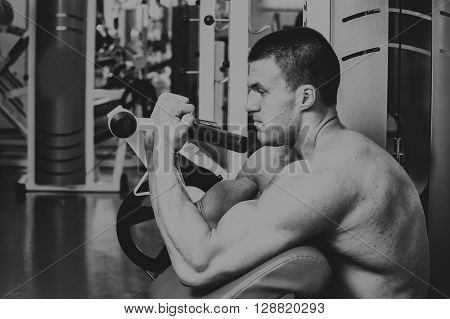 Athlete in the gym making vertical thrust. The power to exercise the muscles of the back. Photos for sporting magazines posters and websites.