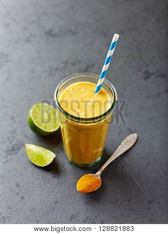 Organic orange and carrot smoothie with turmeric powder