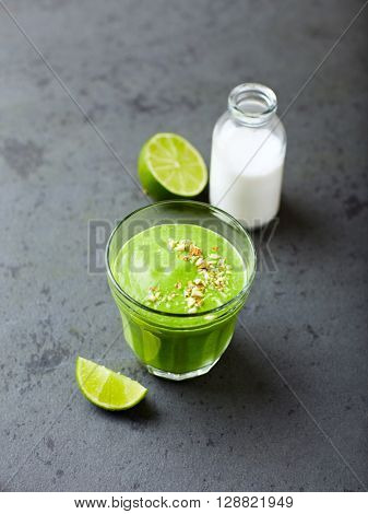 Organic spinach and almond milk smoothie with  almonds