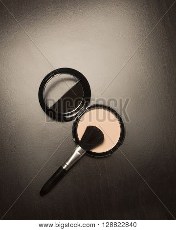 Cosmetic powder with mirror and a brush
