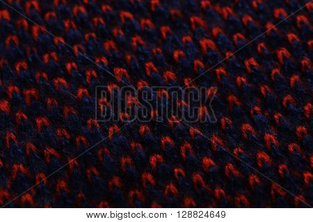 Knitted woolen fabric background on close up
