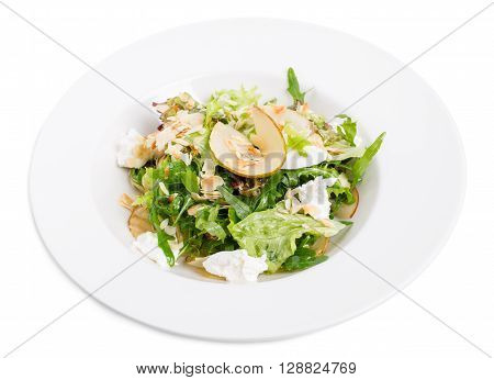 Pear salad with goat cheese and almonds. Isolated on a white background.