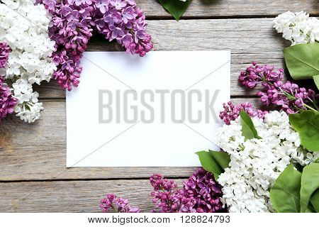 Blooming Lilac Flowers On A Grey Wooden Table