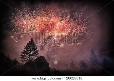 Fireworks into the forest in the amazing summer night Waterfall Toce - Piedmont Italy