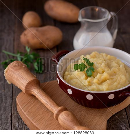 mashed potatoes on vintage rustic wooden background