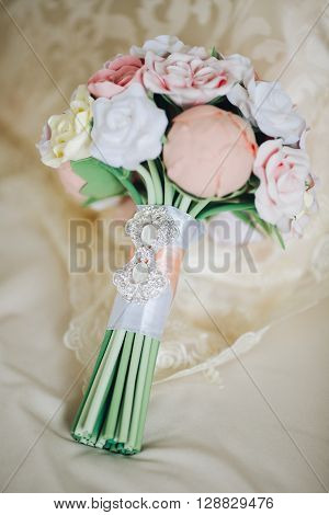 wedding bouquet. Beautiful wedding bouquet in rustic style with roses. a bridal bouquet made of polymer clay