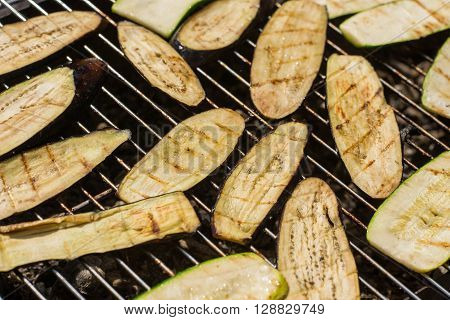fried vegetables (eggplants and zucchini) on a grill