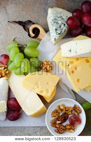 Various types of Cheeses. Top view. Closeup