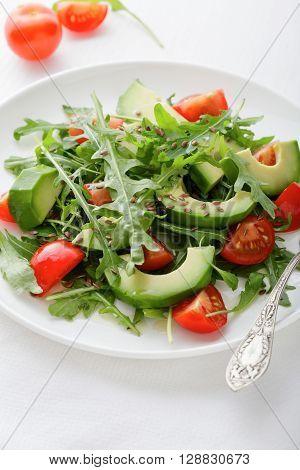 Salad With Avocado, Tomatoes And Arugula