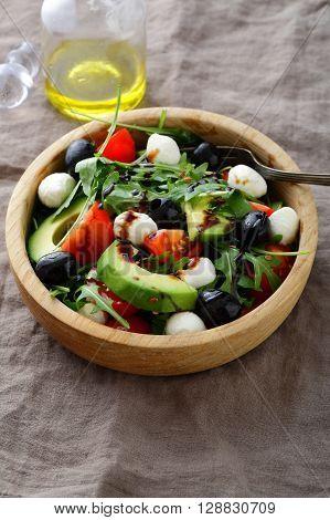 Green Avocado Salad With Cherry Tomatoes, Olive, Mozzarella And Arugula