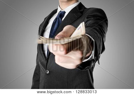 Businessman with blue tie giving you stack of fifty euro bills.