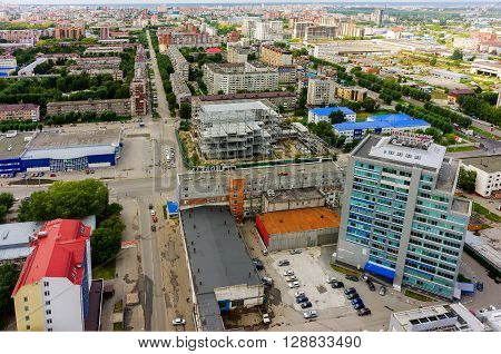 Tyumen, Russia - August 9, 2015: Bird eye view of Nobel-park office building, residential quarters and Permyakova and Energetikov streets intersection