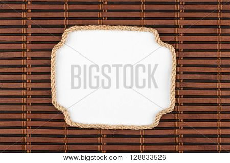 Frame of rope lying on a bamboo mat with a white background for your text view from above