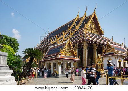 BANGKOK, THAILAND - JANUARY 24, 2015: Unidentified tourists at Wat Phra Kaew in Bangkok, Thailand. Wat Phra Kaew is one of the most popular tourists destination in Thailand.