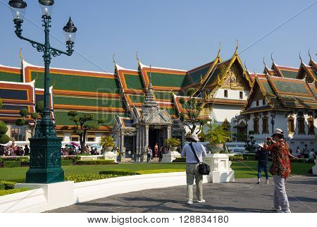 BANGKOK THAILAND - JANUARY 24 2015: Unidentified tourists at Wat Phra Kaew in Bangkok Thailand. Wat Phra Kaew is one of the most popular tourists destination in Thailand.