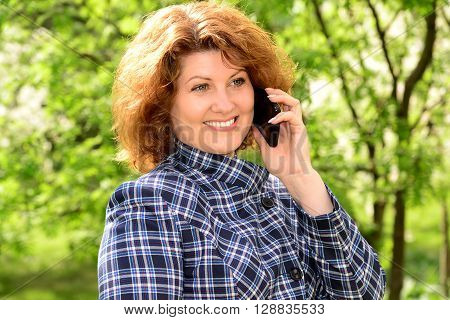Woman talking on a cell phone in the park