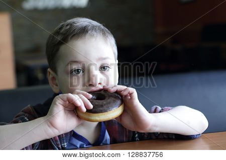 Child Eating Donuts