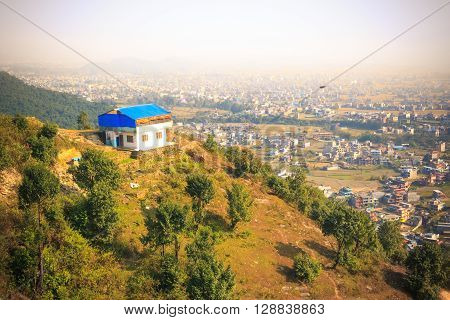 The beautiful city of Pokhara Nepal seen on a foggy day from the top of World Peace Stupa.