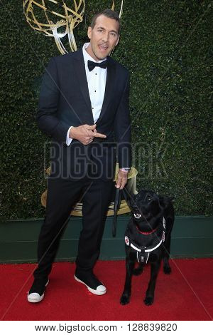 LOS ANGELES - May 1: Brandon McMillan, dog Atlas at The 43rd Daytime Emmy Awards Gala at the Westin Bonaventure Hotel on May 1, 2016 in Los Angeles, California