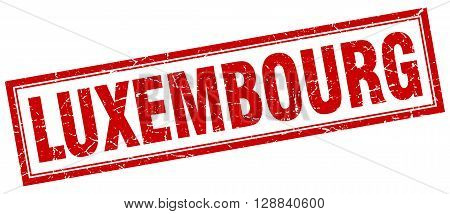 Luxembourg red square grunge stamp on white