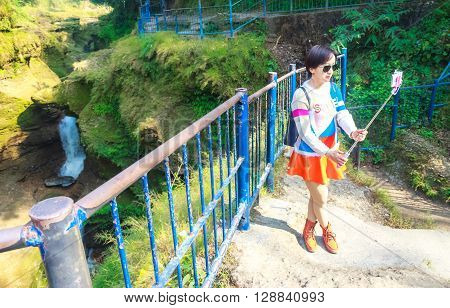 Pokhara Nepal- Dec 11 2015:A foreign tourist is taking selfie at Devi's Fall.