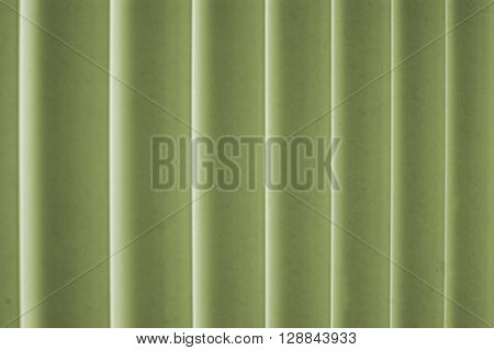 Green and cream color drapes or background material