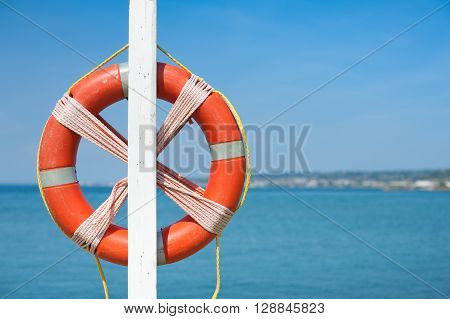 Lifebuoy On Empty Blue Sea In Summer Day