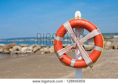 Lifebuoy On Empty Beach In Summer Day
