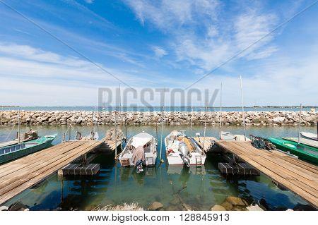 fishing boats moored in a sunny day