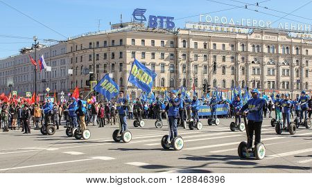St. Petersburg, Russia - 1 May: The line of people on the electric scooters at a demonstration, 1 May, 2016. Day festive demonstration on the Nevsky Prospect in St. Petersburg