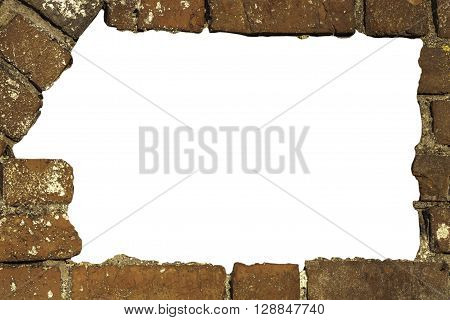 breach in an old red brick wall of an intricate form