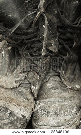 Image of working shoes that are heavily soiled