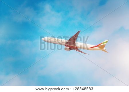 DUBAI, United Arab Emirates - DECEMBER 22, 2016: An Emirates aircraft Boeing 777-31HER is taking off from DXB airport