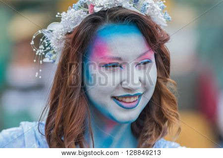 Young Woman With Painted Face