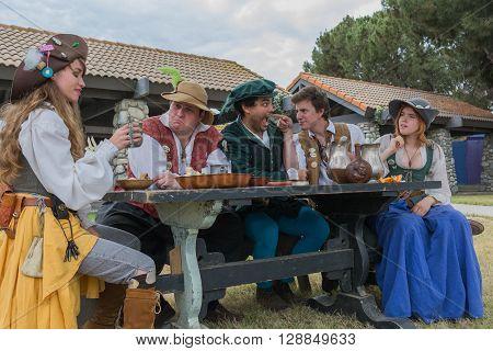 People In Medieval Costumes Performing