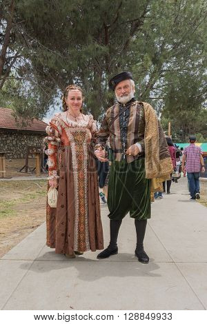 Couple Dressed In Medieval Costume